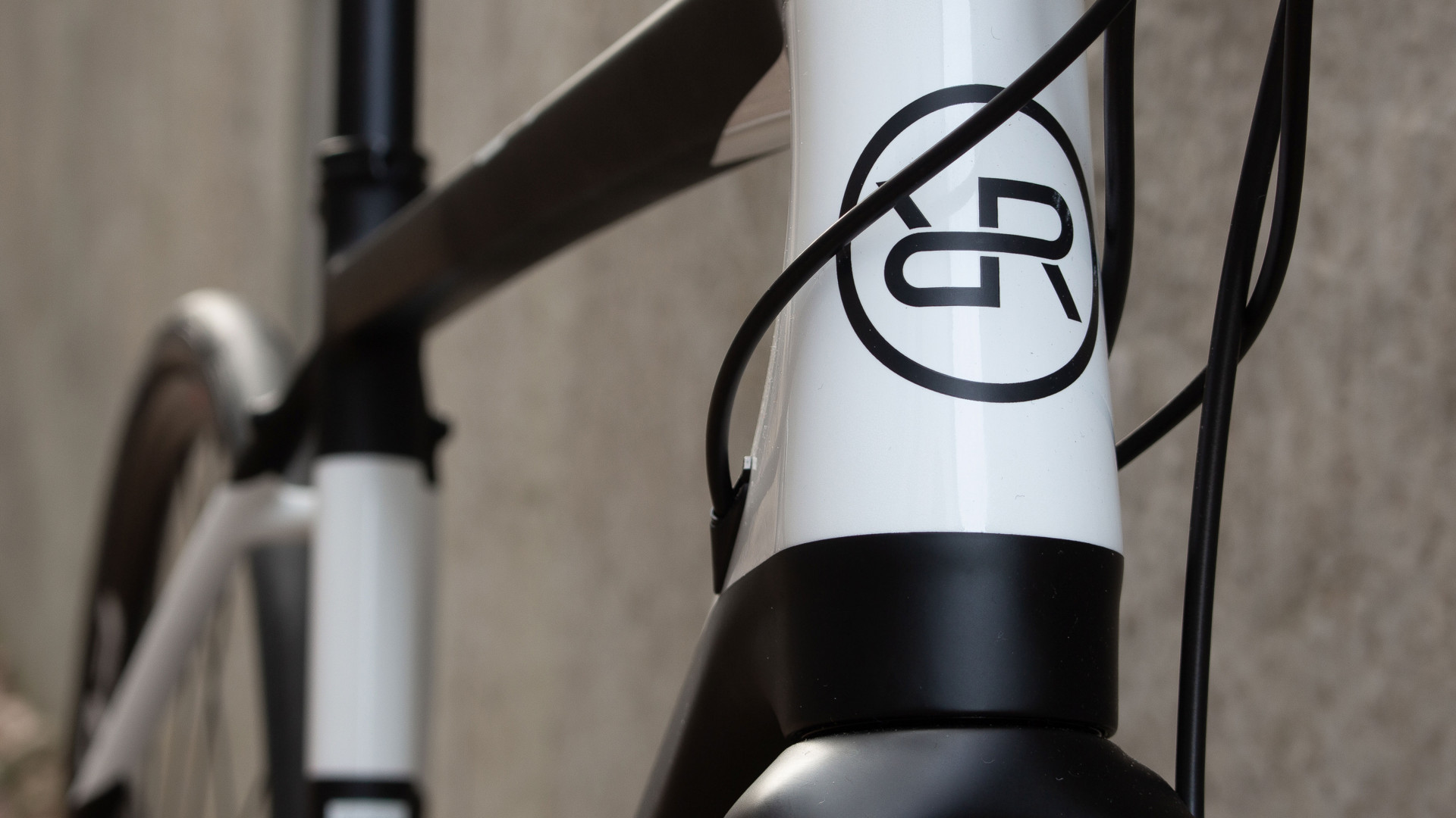 Close up photo of the black carbon bike frame with the Orro Bikes logo finished in black with a white background
