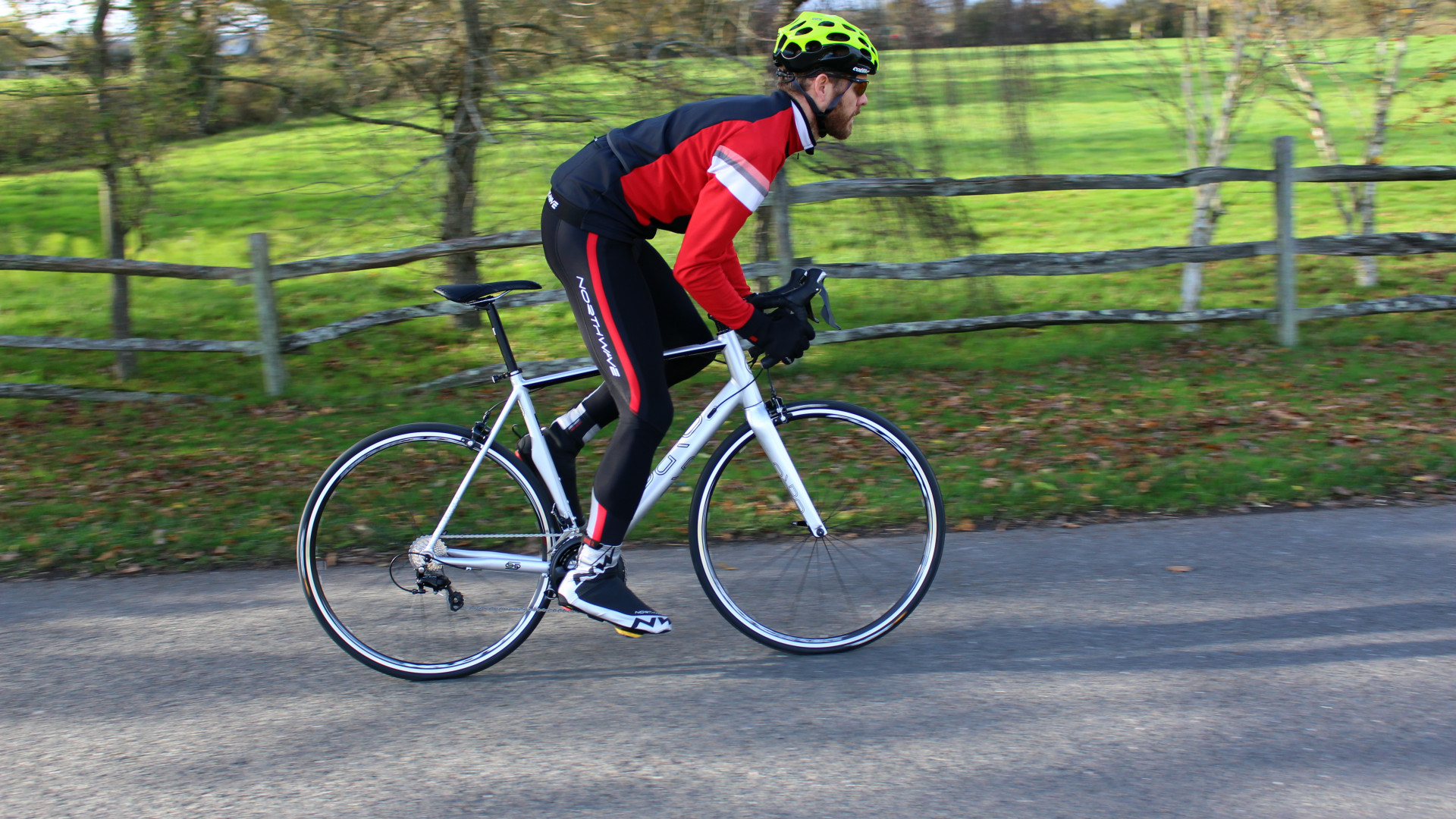 Male cyclist riding his Orro Bike on the Steyning Bostal Strava route with his cycling gear on